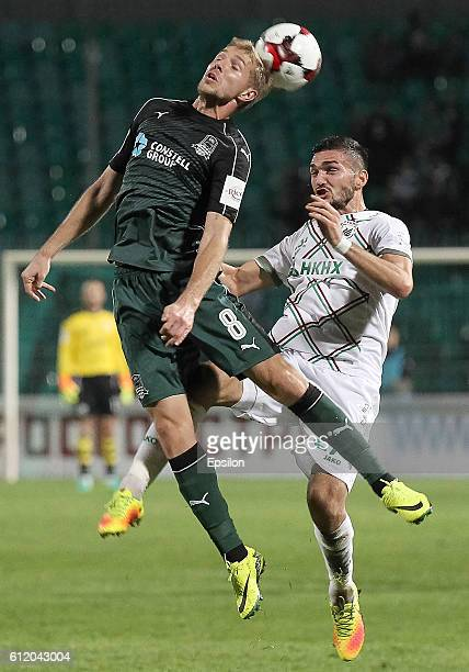 Yuri Gazinski of FC Krasnodar is challenged by Magomed Ozdoyev of FC Rubin Kazan during the Russian Premier League match between FC Krasnodar v FC...