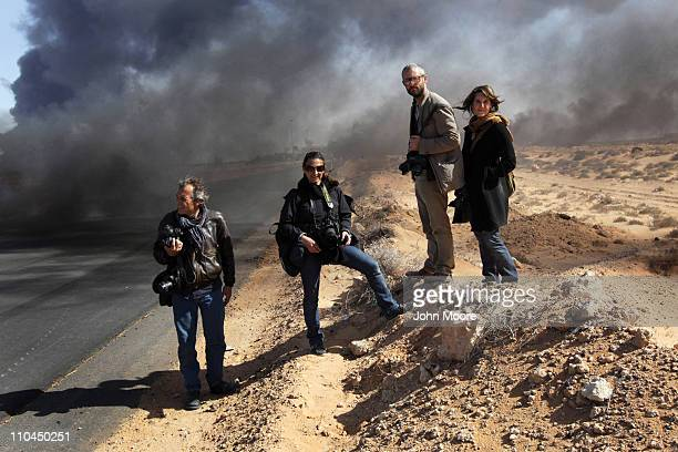 Yuri Kosyrev of Time Magazine Lynsey Addario and Tyler Hicks of the New York Times and freelancer Nicki Sobecki stand during a pause in the fighting...