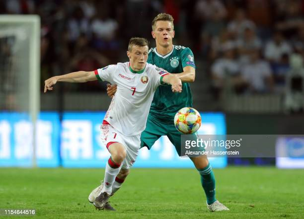 Yuri Kovalev of Belarus is challenged by Matthias Ginter of Germany during the UEFA Euro 2020 qualifier match between Belarus and Germany at...