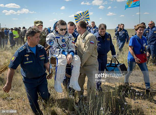 Yuri Malenchenko of Roscosmos is carried to a medical tent after he and Tim Kopra of NASA and Tim Peake of the European Space Agency landed in their...
