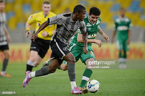 Yuri Mamute of Botafogo battles for the ball with Zezinho of Chapecoense during the match between Botafogo and Chapecoense as part of Brasileirao...