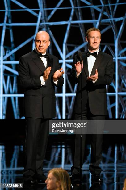 Yuri Milner and Mark Zuckerberg speak onstage during the 2020 Breakthrough Prize at NASA Ames Research Center on November 03 2019 in Mountain View...