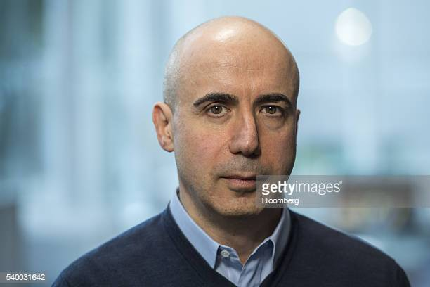 Yuri Milner cofounder of Mailru Group Ltd sits for a photograph during the Bloomberg Technology Conference in San Francisco California US on Monday...