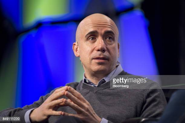 Yuri Milner cofounder of Mailru Group Ltd speaks during the TechCrunch Disrupt 2017 in San Francisco California US on Monday Sept 18 2017 TechCrunch...