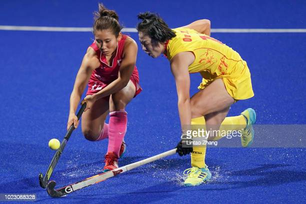 Yuri Nagai of Japan competes against Ou Zixia of China during the women's hockey pool A match between Japan and China on day seven of the Asian Games...