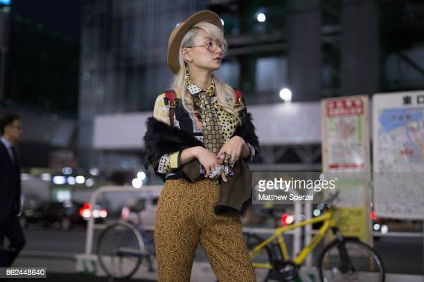 Yuri Nakagawa is seen attending Fashion Hong Kong during Tokyo Fashion Week wearing vintage gold pants with a brown hat on October 17 2017 in Tokyo...