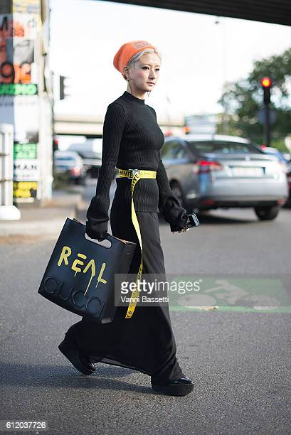 Yuri Nakagawa poses with a Gucci bag and Off White belt after the Balenciaga show at the Paris Event Center during Paris Fashion Week Womenswear SS17...