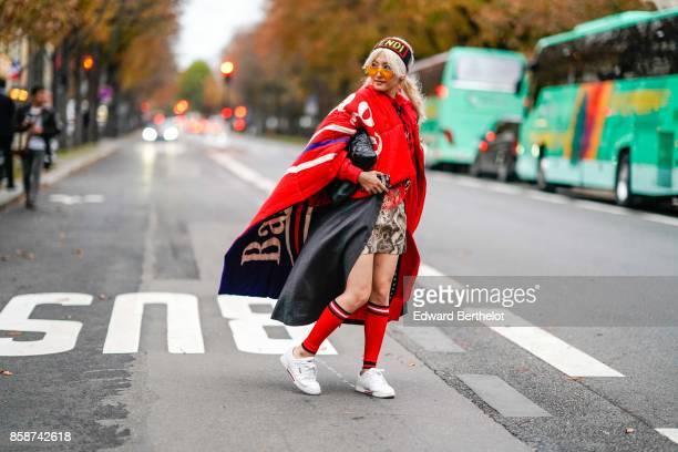 Yuri Nakagawa wears a Balenciaga oversize red cape outside John Galliano during Paris Fashion Week Womenswear Spring/Summer 2018 on October 1 2017 in...