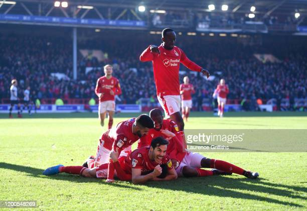 Yuri Ribeiro of Nottingham Forest leads the celebrations after Joe Lolley scores the second goal during the Sky Bet Championship match between...