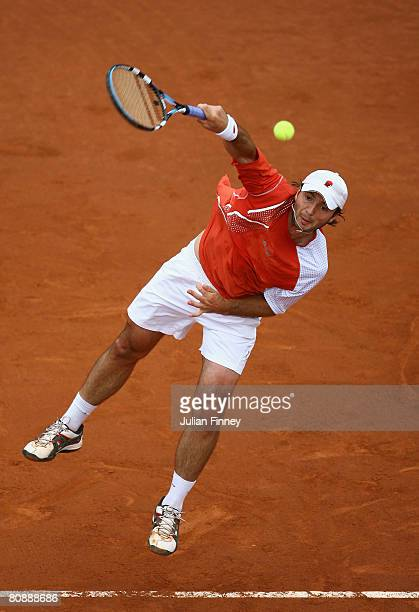Yuri Schukin of Kazakhstan serves to Robby Ginepri of United States during the Open Sabadell Atlantico Barcelona 2008 Tennis at the Real Club on...