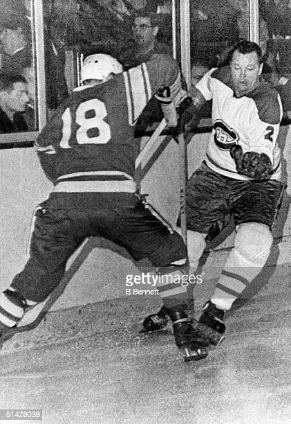 Yuri Volkov of the Russian National Hockey Team ties up Doug Harvey of the Montreal Canadiens during an exhibition game on December 11 1964 at the...