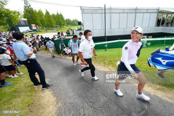 Yuri Yoshida of Japan celebrates after winning the tournament following the final round of Rakuten Super Ladies at Tokyu Grand Oak Golf Club on July...