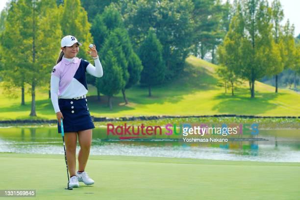 Yuri Yoshida of Japan celebrates winning the tournament on the 18th green during the final round of Rakuten Super Ladies at Tokyu Grand Oak Golf Club...