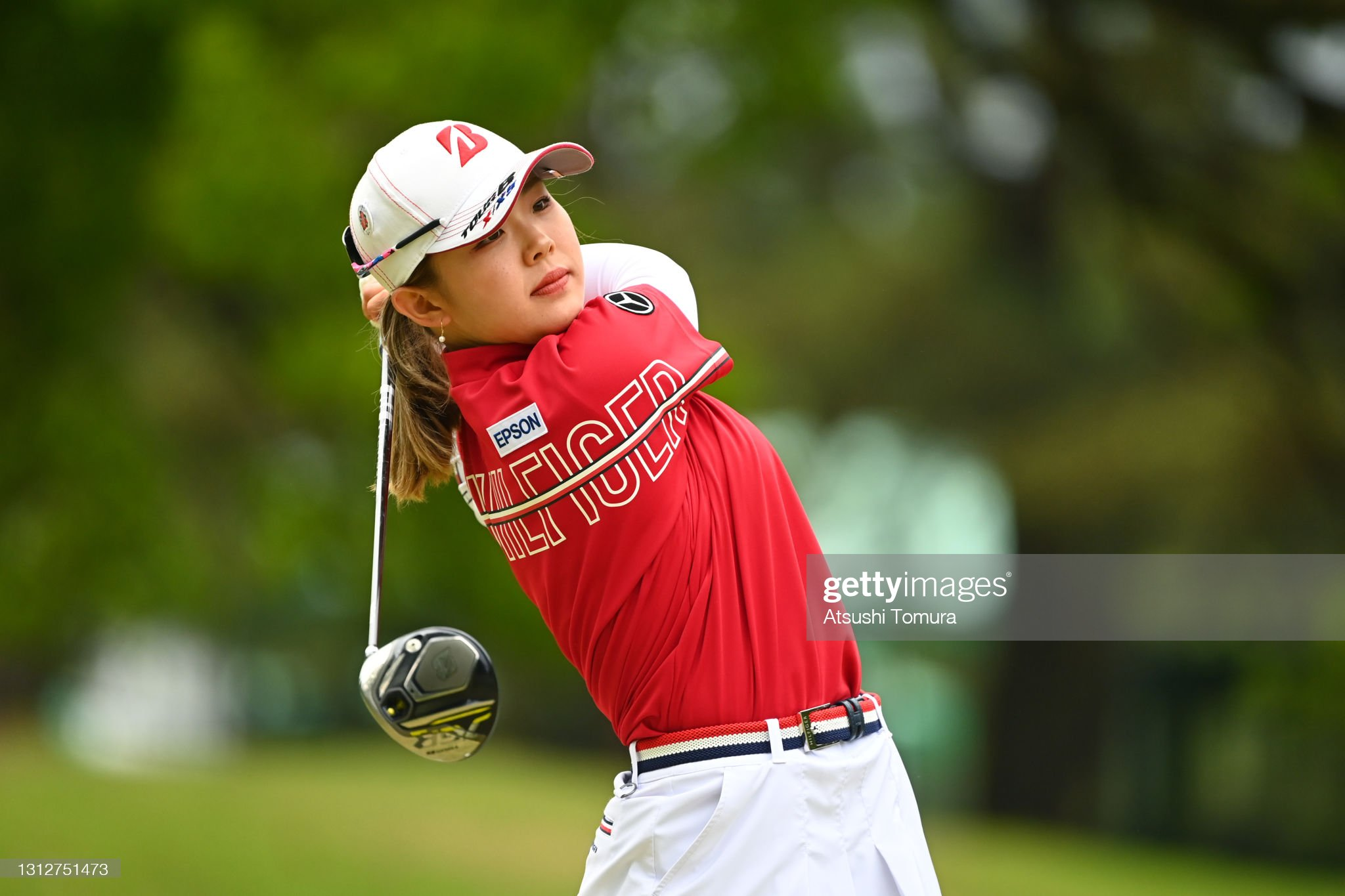 https://media.gettyimages.com/photos/yuri-yoshida-of-japan-hits-her-tee-shot-on-the-17th-hole-during-the-picture-id1312751473?s=2048x2048