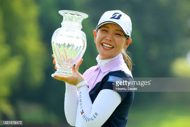 Yuri Yoshida of Japan poses with the trophy after winning the tournament following the final round of Rakuten Super Ladies at Tokyu Grand Oak Golf...