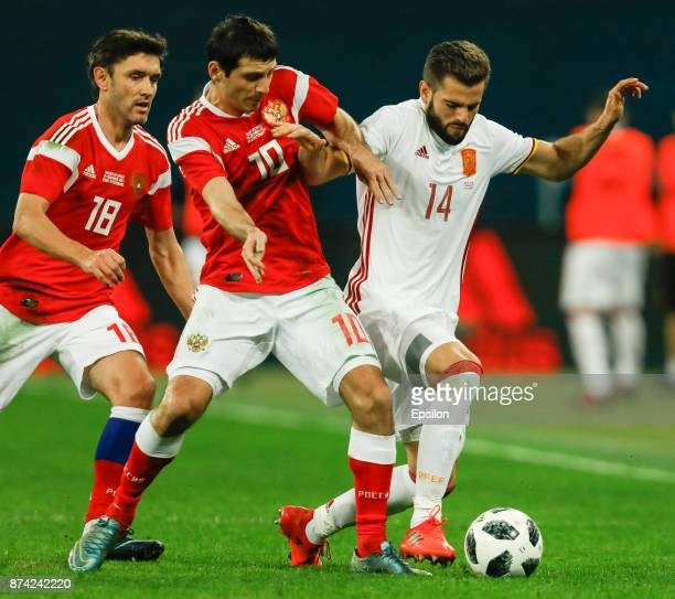 Yuri Zhirkov and Alan Dzagoev of Russia vie for the ball with Nacho of Spain during Russia and Spain International friendly match on November 14 2017...