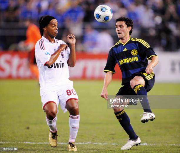 Yuri Zhirkov of Chelsea and Ronaldinho of AC Milan battle for the ball during the first half of the World Football Challenge at M&T Bank Stadium on...