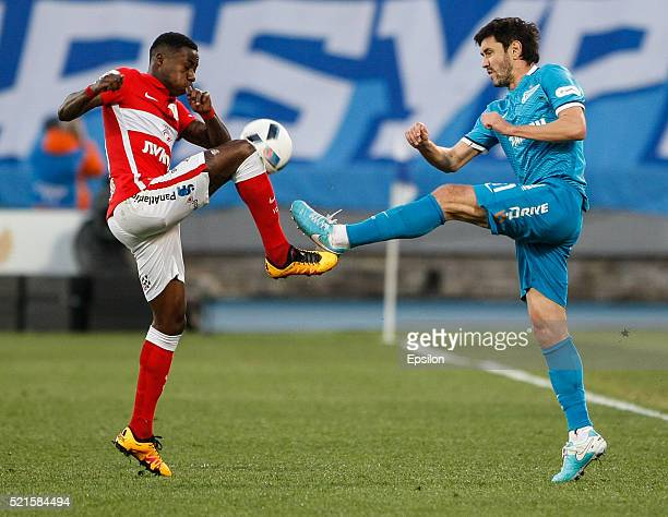 Yuri Zhirkov of FC Zenit St Petersburg and Quincy Promes of FC Spartak Moscow vie for the ball during the Russian Football League match between FC...