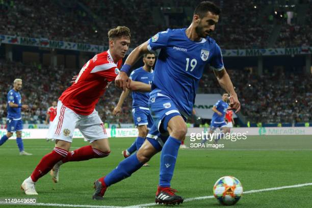 Yuri Zhirkov of Russia and Cyprus Konstantinos Laifis are seen in action during the EURO 2020 Qualifiers round 4 march between Russia and Cyprus at...