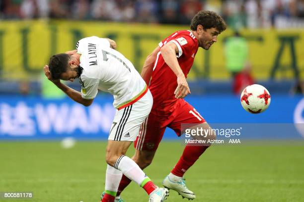Yuri Zhirkov of Russia clashes with Miguel Layun of Mexico prior to his sending off during the FIFA Confederations Cup Russia 2017 Group A match...