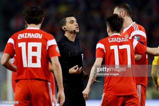 Yuri Zhirkov of Russia referee Ovidiu Hategan Aleksandr Golovin of Russia during the EURO Qualifier match between Belgium v Russia at the Koning...