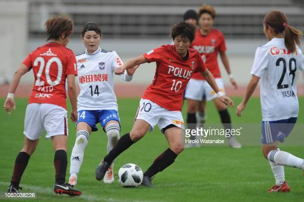 Yuria Obara of Albirex Niigata Ladies and Chinatsu Kira of Urawa Red Diamonds Ladies compete for the ball during the Nadeshiko League match between...