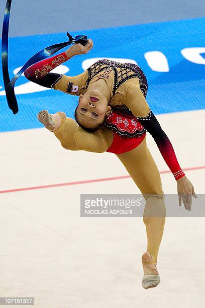 Yuria Onuki of Japan performs during the rhythmic gymnastics individual allaround final during the 16th Asian Games on November 26 2010 Anna...