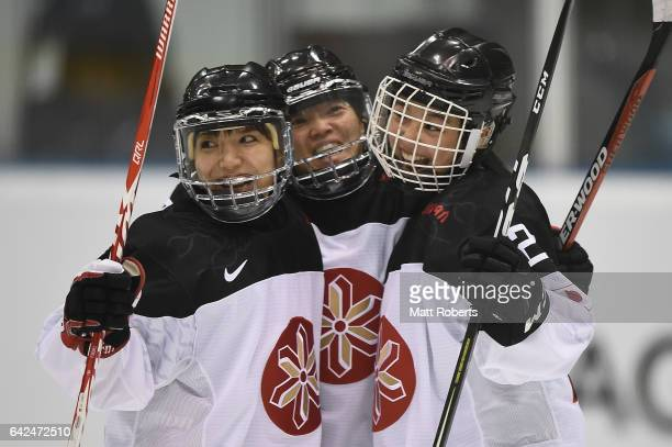 Yurie Adachi Shoko Ono and Yoshino Enomoto of Japan celebrate during the Women's Ice Hockey match between Kazakhstan and Japan on the day one of the...