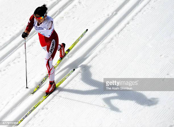 Yurika Abe of Japan competes in the women's 15km standing crosscountry skiing during day three of Sochi 2014 Paralympic Winter Games at Laura...