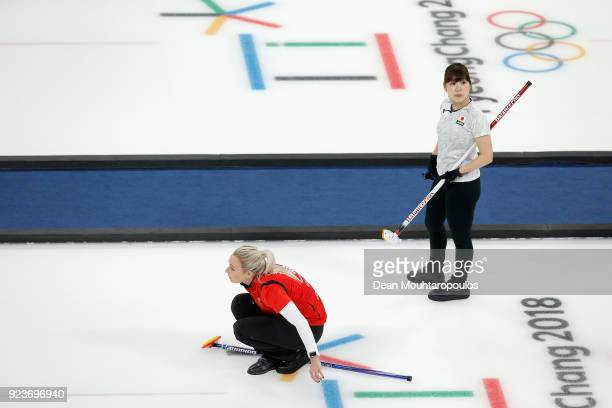 Yurika Yoshida of Japan watches on as Anna Sloan of Great Britain competes during the Curling Womens' bronze Medal match between Great Britain and...