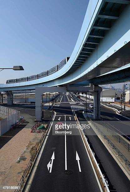 A Yurikamome driverless train travels along an elevated track in the Toyosu area of Tokyo Japan on Sunday March 16 2014 Japan's Ministry of Land...