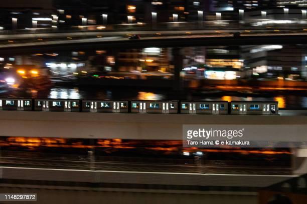 Yurikamome train running on Rainbow Bridge in Tokyo