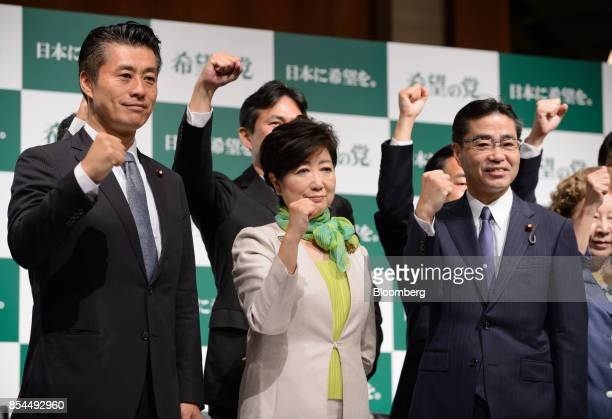 Yuriko Koike governor of Tokyo and head of the Party of Hope center poses for a photograph along with other party members including Goshi Hosono a...