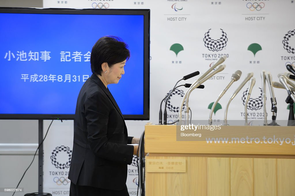 Yuriko Koike, governor of Tokyo, arrives at a news conference in Tokyo, Japan, on Wednesday, Aug. 31, 2016. Koike told reporters that the move of the iconic Tsukiji fish market to a new site in Toyosu will be postponed. Photographer: Akio Kon/Bloomberg via Getty Images