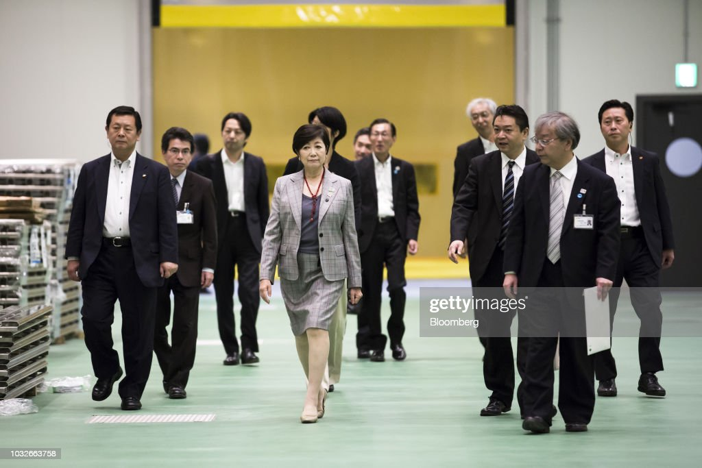 Yuriko Koike, governor of Tokyo, center left, inspects the fish wholesale area at Toyosu Market in Tokyo, Japan, on Thursday, Sept. 13, 2018. The Toyosu Market, where the iconic Tsukiji fish market will relocate to, is scheduled to being operations on Oct. 11. Photographer: Tomohiro Ohsumi/Bloomberg via Getty Images