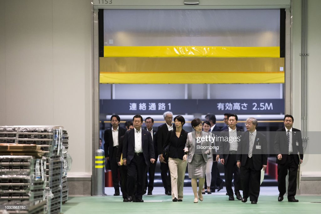 Yuriko Koike, governor of Tokyo, center, speaks as she inspects the fish wholesale area at Toyosu Market in Tokyo, Japan, on Thursday, Sept. 13, 2018. The Toyosu Market, where the iconic Tsukiji fish market will relocate to, is scheduled to being operations on Oct. 11. Photographer: Tomohiro Ohsumi/Bloomberg via Getty Images