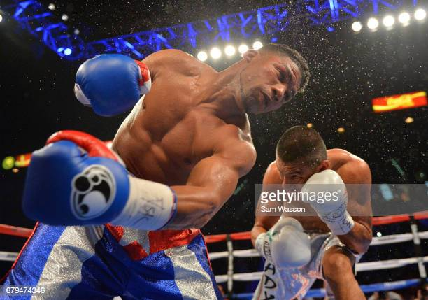 Yuriorkis Gamboa throws a left at Robinson Castellanos during their lightweight fight at MGM Grand Garden Arena on May 5 2017 in Las Vegas Nevada...