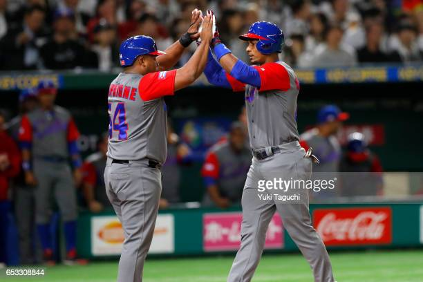 Yurisbel Gracial of Team Cuba is greeted by teammate Alfredo Despaigne after hitting a tworun home run in the second inning during Game 4 of Pool E...