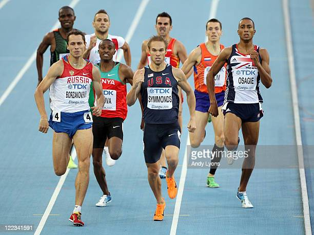 Yuriy Borzakovskiy of Russia, Nick Symmonds of United States and Andrew Osagie of Great Britain race for the line during the men's 800 metres semi...