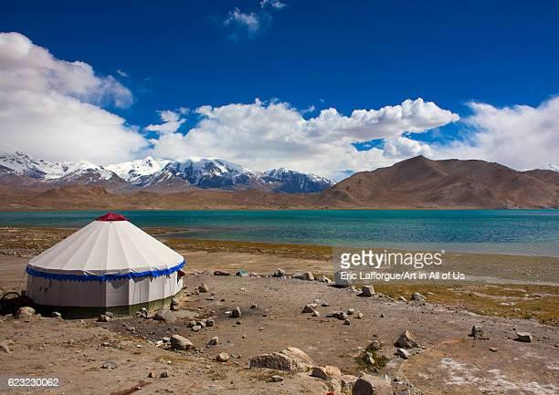 Yurt and mountain scenery at Kara Kul lake on the Karakoram highway, Xinjiang Uyghur Autonomous Region, China on September 21, 2012 in Karakul Lake,...