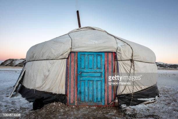 yurt at sunrise, altai mountains in winter, mongolia - yurt stock pictures, royalty-free photos & images