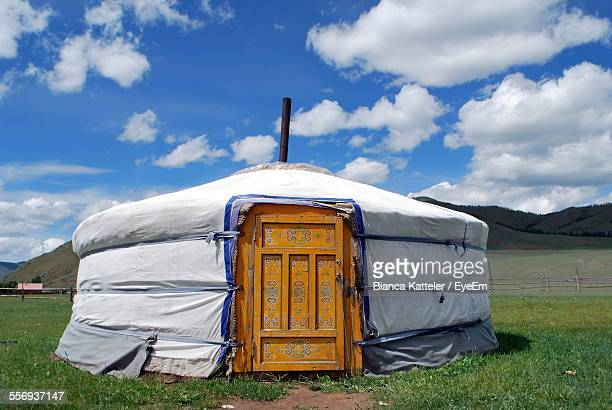 Yurt On Grassy Field Against Sky