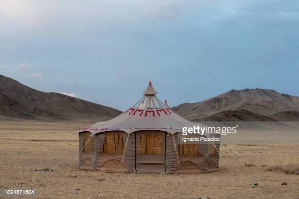 yurts (mongolian gers), altai mountains in western mongolia - yurt stock pictures, royalty-free photos & images