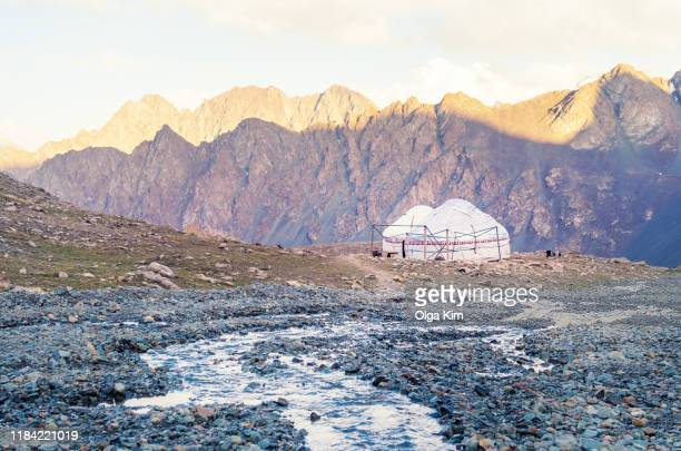 yurts and river in the mountains. a beautiful scenery of mountain nature in the morning - kazakhstan stock pictures, royalty-free photos & images