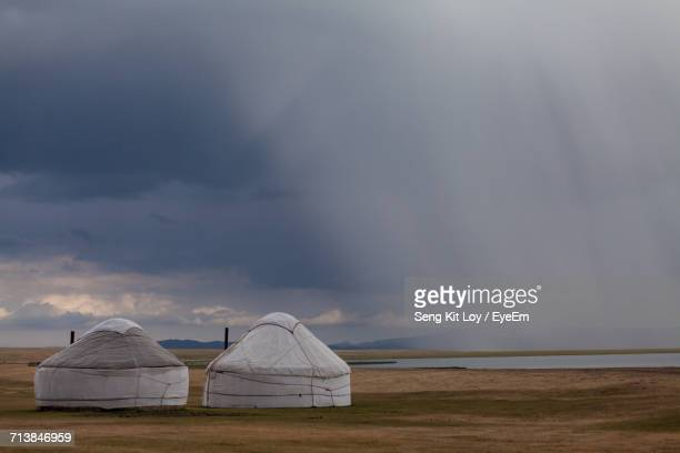 Yurts By Song Kol Lake Against Cloudy Sky