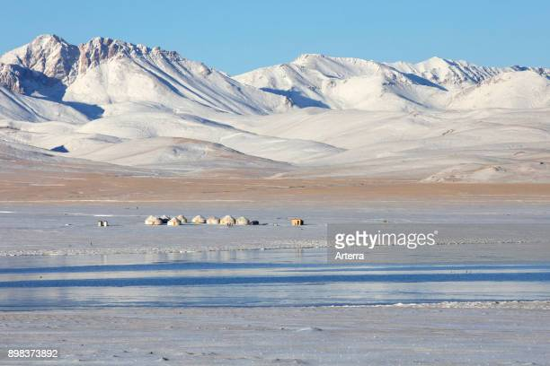 Yurts in traditional Kyrgyz yurt camp in the snow along Song Kul / Song Kol lake in the Tian Shan Mountains Naryn Province Kyrgyzstan