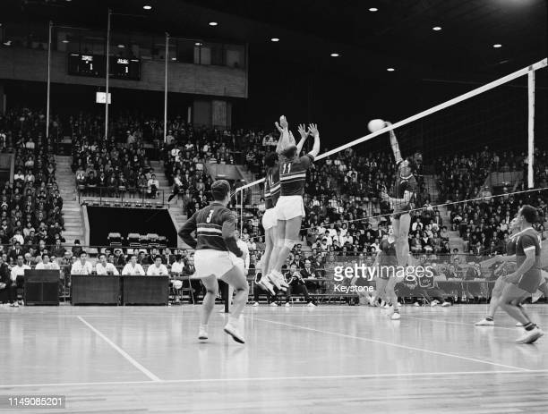Yury Chesnokov of the Soviet Union attempts a kill ball against Tibor Florian, Ferenc Janosi and Mihaly Tatar of Hungary during their Men's Olympic...