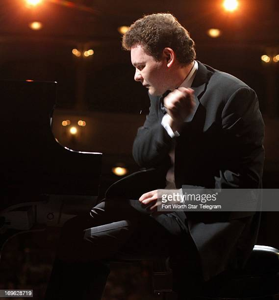 Yury Favorin of Russia finishes his performance during the fourth day of the preliminary round of the 14th Van Cliburn International Piano...
