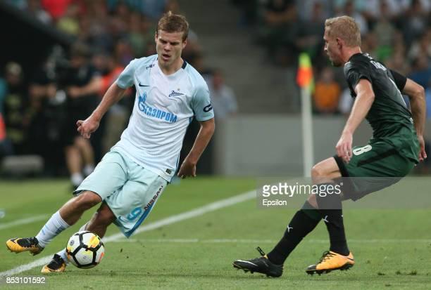 Yury Gazinsky of FC Krasnodar is challenged by Aleksandr Kokorin of FC Zenit St Petersburg during the Russian Premier League match between FC...