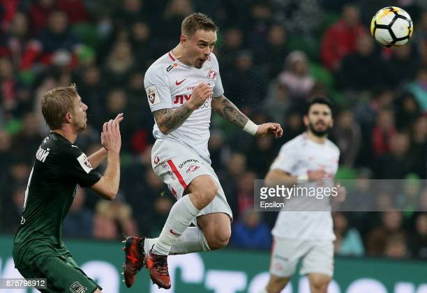 Yury Gazinsky of FC Krasnodar vies for the ball with Andrey Yeshchenko of FC Spartak Moscow during the Russian Premier League match between FC...